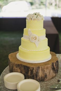 Beautiful yellow wedding cake for a rustic themed wedding