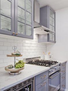 AFTER: white subway tile backsplash grey glassfront kitchen cabinets