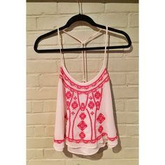 UO Embroidered Top Worn a few times but in perfect condition. Bright pink embroidering in the front. Spaghetti straps that turn into a rope strap in the back as pictured. Double layered white fabric. Urban Outfitters Tops