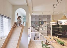 The slide was designed especially for the family's little girl, and is accessed via a set of stairs that double up as a bookcase.