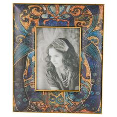 Showcase a vacation snapshot or family photo in this eye-catching picture frame, featuring a peacock motif in blue and gold.  Produc...