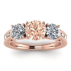 Piece Info: - 14K Rose Gold - Comfort Fit - Hypoallergenic, Cobalt-Free - Sleek Design - Durable - Comes in a Gift box #14k #Rose #Gold #Capri #3 #Stone #Morganite #And #Diamond #Baguette #Engagement #Ring #Baguette #Accents #Milgrain #leaves #Engraving #bezel #Accents #14k #morganite #ring #18k #morganite #ring #rose #gold #engagement #wedding #ring #engagement #ring #rose #gold #morganite #morganite #ring #morganite #engagement #baguette #accents #milgrain #leaves #engraving #bezel Baguette Engagement Ring, Baguette Ring, Baguette Diamond Rings, Three Stone Engagement Rings, Morganite Ring, Morganite Engagement, Pink Tourmaline, Wedding Ring Bands, Diamond Shapes