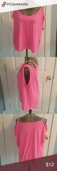 Victoria's Secret PINK Tee Small pen mark on front, see last picture.  Cold shoulder style with shoulder cut out. Oversized arm holes - kind of a muscle shirt vibe. PINK Victoria's Secret Tops