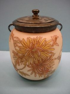 Mt Washington Crown Milano Biscuit Jar Shaded Background with Chrysanthemum Decoration. 6 1/2 Inch HOA and 6 Inch DOA. Signed CM On Bottom and Signed MW in Lid.
