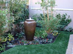 like this water feature. may do this in place of pool waterfall ;)