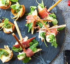 Serrano-wrapped pear with goat's cheese- These canapés look fancy, but are incredibly easy to assemble, and look lovely as part of a sharing platter or party nibble. Christmas Nibbles, Christmas Canapes, Christmas Party Food, Xmas Food, Christmas Cooking, Christmas Recipes, Canapes Recipes, Appetizer Recipes, Easy Canapes
