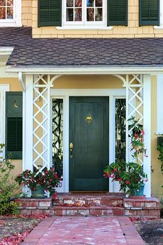 Green Front Door on Yellow Colonial Style Home Craftsman Cottage, Craftsman Style, Town And Country, Country Living, Porch Trim, Green Front Doors, Colonial Style Homes, Transom Windows, Cottages By The Sea