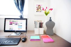 Organized and colorful desk with computer and tulips