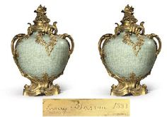 A PAIR OF LOUIS XV STYLE ORMOLU-MOUNTED CHINESE CELADON PORCELAIN VASES AND COVERS