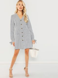 77d64a88f7 Shop Button   Pocket V-Neck Striped Dress online. SHEIN offers Button    Pocket V-Neck Striped Dress   more to fit your fashionable needs.