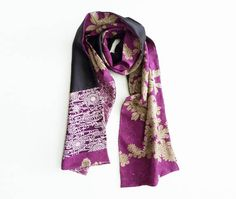 This beautiful double sided silk scarf is made from a selection of vintage kimono fabrics pieced together. It uses a colour palette of purple, grey and white vintage kimono fabrics on one side, the other side is made from a black silk fabric. This is a decorative scarf and perfect for enhancing an outfit, either draped over the shoulders like a wrap or draped around the neck as a scarf. This scarf is double sided and can change look dramatically, depending on how you use it and which…