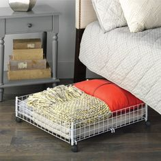 This rolling basket can contain your bed's accent pillows while you're counting sheep.  **For the guest room**