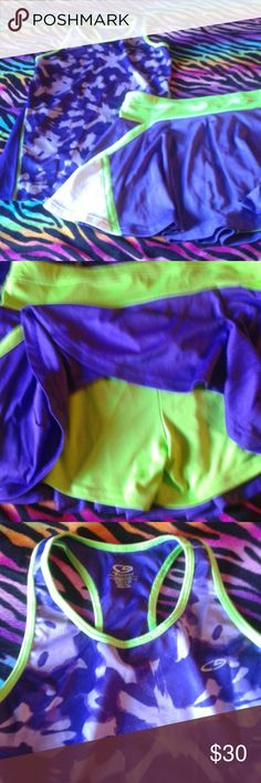 Champion athletic skirt and tank top set Purple and neon green shorts underneath and I am pictured wearing it once at a tennis tournament. I was a size medium 5/6 then and all my other athletic outfits in my closet fits like this. Champion  Shorts Skorts