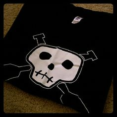 NWOT - Skull with Paddles Shirt NWOT - Never worn. Skull with paddles design. Very soft and stretchy.   100 %Cotton   Accepting reasonable offers. Sorry, no trades. bella  Tops Tees - Short Sleeve