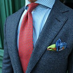 Use patterns. This is a great example of having 4 different patterns (tie, pocket square, blazer, shirt) yet it works and looks surprisingly simple and elegant.Looks great.