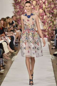 Oscar de la Renta spring 2015 collection - look at the the flowers in the back, the entire collection is like wearing a garden! ultimate florals