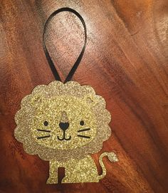 Who says the only thing roaring in your home this holiday season should be a fire?  #gold #glitter #christmas #christmasornaments #christmasdecor #stockingstuffers #customorder #custom #holidays #etsy #etsyshop #handmade #paperornaments #lion #alphie #adpi #alphadeltapi