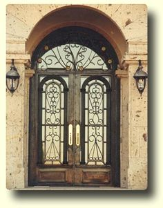 Wrought Iron Doors.....I LOVE LOVE LOVE my wrought iron double door as our front door!!!!!!!  Ours is different than this one but I would not have any other front door!