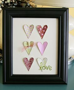 Framed hearts.  This could be a very thrifty gift for Valentines day:  Frame from a charity shop.  Hearts cut from wallpaper samples (free from DIY stores) and a plain sheet of paper as backing to glue the hearts to.  This would be lovely either hanging or in a  'stand up frame' -  it could then stand on a desk or shelf.