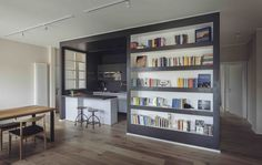 Black built in bookcase with white backing and shelves
