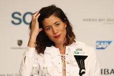 Garbine Muguruza Photos Photos - Garbine Muguruza of Spain talks during All Access Hour prior to the BNP Paribas WTA Finals Singapore at Marina Bay Sands on October 22, 2016 in Singapore. - BNP Paribas WTA Finals: Singapore 2016 - Previews