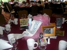 create a centerpiece based on a happening your senior year - Miss Tennessee visited the school during this class' senior year, and memories of that day were gathered to make a centerpiece