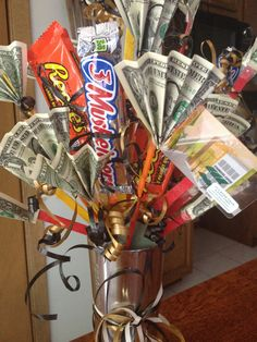 Grad bouquet!  Starbucks travel mug with a floral brick.  Use Popsicle sticks and ribbons to hold gift cards, fanned dollar bills and candy.  Lotto tickets work too!