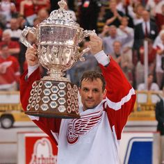 """Stevie Y bucks superstition and hoists the Campbell Bowl as Western Conference champions in Steve Yzerman, Hockey Hall Of Fame, The Mitten State, Red Wings Hockey, Nhl Players, Season Ticket, Western Conference, Go Red, Michigan Wolverines"