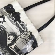 """Retro Photo Purse Super cute retro photo purse with lots of pockets and soft plus light to carry! Dimensions: 14""""x10.5""""x3.5"""" Strap height { purse to highest point of handle } 12"""" Rolfs Bags"""