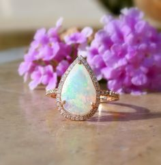 Opal Engagement Ring, Opal and Diamond Ring, Welo Opal Ring, Opal Ring, Ethiopian Opal, Engagement Ring, Rose Gold, 14kt by AleaMariCo on Etsy https://www.etsy.com/listing/231155582/opal-engagement-ring-opal-and-diamond