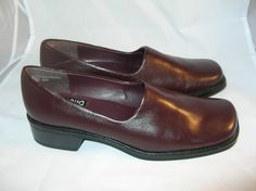 Here we have a pair of 8 1/2 M Mootsie Tootsie shoes for sale.  They appear to be new but I cant say for sure.  They are brown slip ons and the uppers are super soft.  The soles are rubber for comfort.  The left shoe has a mark on the heel.  Check it out on Ebays magnification program.