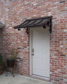 Metal awning for our carport side door Front Door Awning, Porch Awning, Door Overhang, Window Awnings, Front Windows, Backyard Canopy, Garden Canopy, Canopy Outdoor, Copper Awning