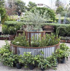 Round, steel raised beds? Yep!  http://rogersgardens.com/outdoor-gardens-garden-rooms/