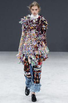 Floral print/colors on left side.     Viktor & Rolf Fall 2016 Couture Fashion Show - Estella Boersma