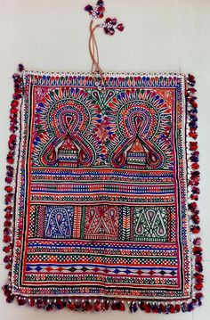 Rabari embroidery from Kutch, Gujarat, India. Cupboard and parrot motif.