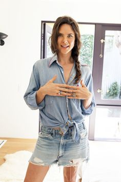 Her cut-offs: Levi's. Her shirt: A thrift store find with a JC Penny label.