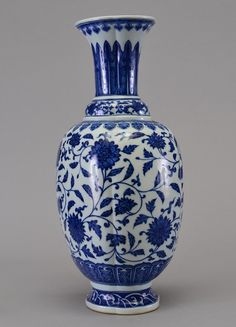 A BLUE AND WHITE VASE, well-painted in brilliant cobalt-blue tones with simulated 'heaping and piling', the baluster body encircled by two bands, the upper with continuous lotus scroll, the lower with a composite floral meander, all between slightly raised double-line borders. 19 1/4 in. tall. Qing Dynasty