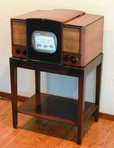 50s TV.  Our TV was very similar to this.  We had a round screen. *