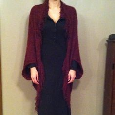 "✨NEW LIST✨ Free People Open Cardigan W/Fringe Burgundy and black, fringe bordered fuzzy open front cardigan. Drop shoulder, no sleeves, just arm holes fits like a giant warm amazing shawl. No defects in great shape worn a few times. Measurements taken with item laying down flat and are approximate but I try my best length 49"" including fringe. Machine washable 60% nylon, 40% acrylic. Free People Sweaters Cardigans"