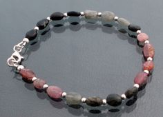 Multi colour tourmaline bracelet with sterling silver spacer beads and clasp