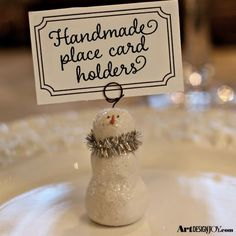 Add holiday joy to your table with these simple to make snowman place card holders! Also great for displaying photos and recipe cards!