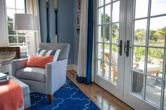 French doors flood the guest bedroom with natural light and provide easy access to the outdoor patio.