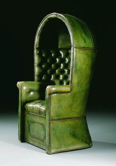 A Regency Hall porter's chair sold by Christie's on a fine english furniture auction in 1999. The domed top, the back, the sides and the seat are covered in close-nailed green leather. A porter's chair was a type of chair used in medieval England and later France by a gatekeeper servant. Since there were often cold breezes near a front door, the chair was designed to envelop and keep the servant relatively warm #canopychair #concierge #interiordesign - More wonders at…