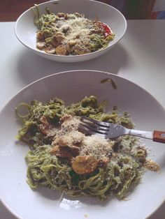 Spnach pasta with champignon sauce and pasmesan.