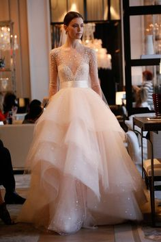 Long sleeve sparkle confetti tulle ball gown with tiered horsehair skirt by Monique Lhuillier // Best of Bridal Week 2016 - Part 1