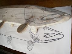 This is the start of a wonderful carving. This will be a wood carved replica of a 35 in/ 88 cm long Northern pike. Fish Wood Carving, Dremel Wood Carving, Fish Gallery, Wood Carving For Beginners, Driftwood Fish, Decoy Carving, Fishing Signs, Lake Decor, Wooden Fish