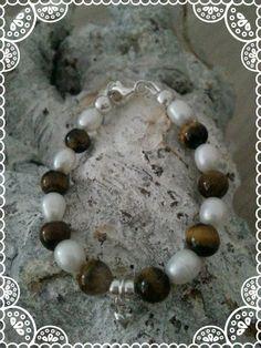 https://www.facebook.com/parelsenstrikjes  baby bracelet De dochter armband uit de serie TO  Armband Moos   Babyarmband:€16.95   Kinderarmband : €18.95   Gemaakt van de tijgeroog kraal gecombineerd met sterling zilver en zoetwaterparels
