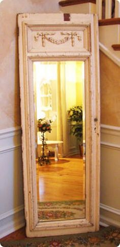 what a clever idea...get an old door and insert a mirror.  Great repurposing