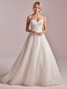 Rebecca Ingram - REMY, We present a pretty notion: a strapless lace ballgown wedding dress designed to flaunt your angles at the perfect price point. Thoughts?