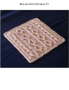 Cable/Aran Square pattern by Mary Jane Hall - Pattern along with 22 other different cable patterns for Pam's Comfort Cables Afghan by various designers - Pattern is $4.99 at Knit Picks